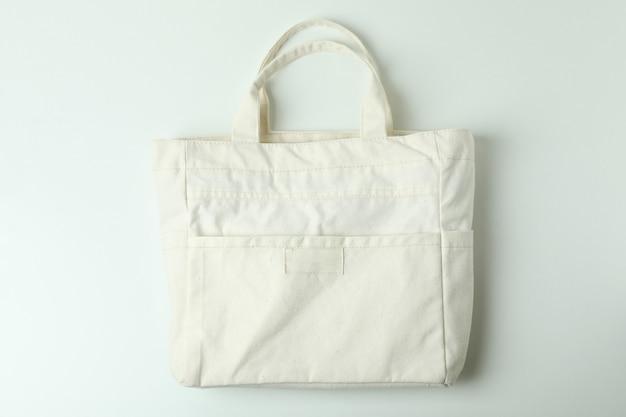 Blank stylish eco bag on white background