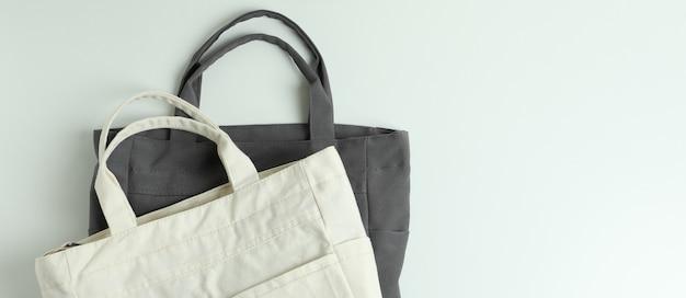 Blank stylish eco bags on white