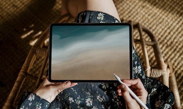 Blank tablet screen with dark blue ocean