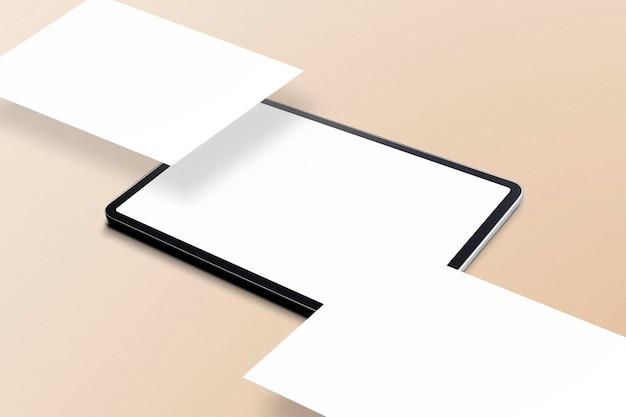 ベージュの背景に空白のタブレット画面