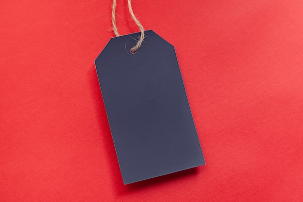 Blank tag for black friday or sale action in shop on the red background. discount sticker template.