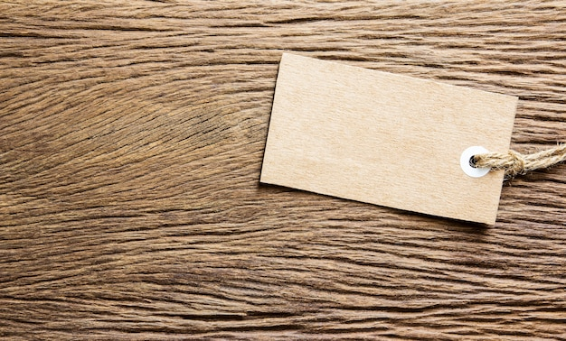 Blank tag tied on wooden background