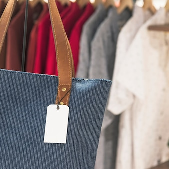 Blank tag on a tote bag in a store