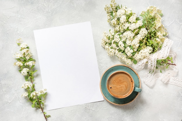 Blank for text, morning black coffee, and bouquet white spring flowers