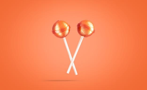 空白の2つのキャラメルロリポップモックアップオレンジ色の背景空の甘い吸盤ボールデザートモックアップ