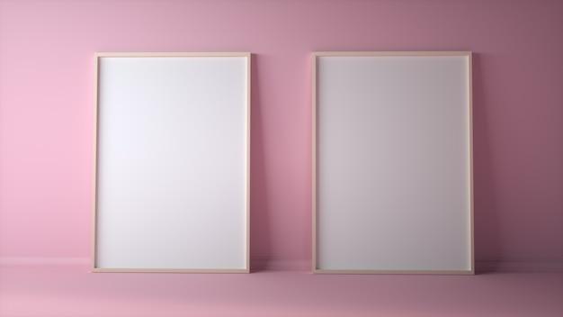 淡いピンクの壁のモックアップに空白の2つのフォトフレーム