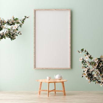 녹색 벽에 서 서 모의 빈 세로 포스터 프레임