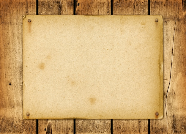 Blank vintage paper nailed on a wood board