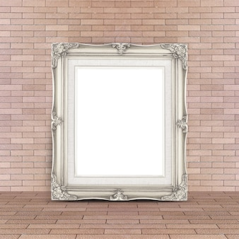 Blank vintage white picture frame leaning at red brick floor and wall