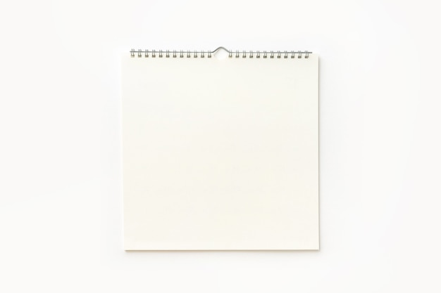 Blank wall calendar on white background.