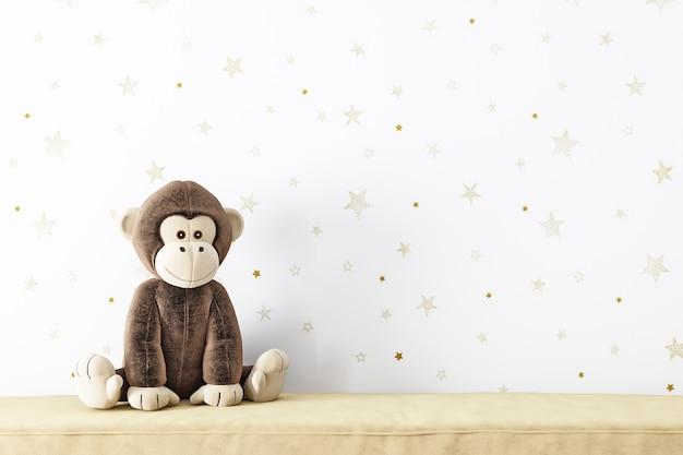 빈 벽 모형과 봉제 장난감 원숭이