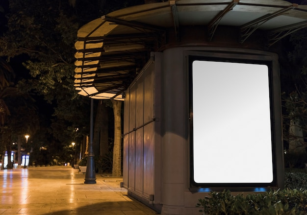 Blank white advertisement panel in city