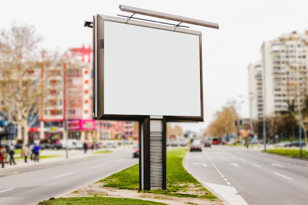 Blank white advertising board in empty street