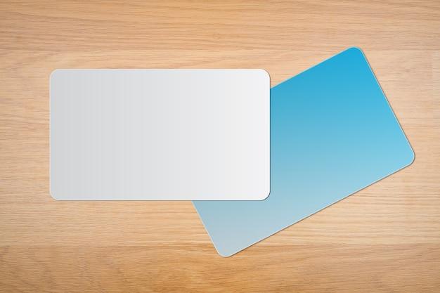 나무 배경 빈 흰색과 파란색 비즈니스 카드. 텍스트