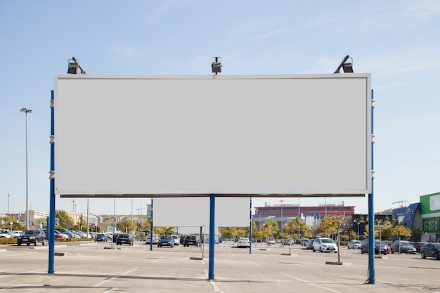 Blank white billboard in the parking lot
