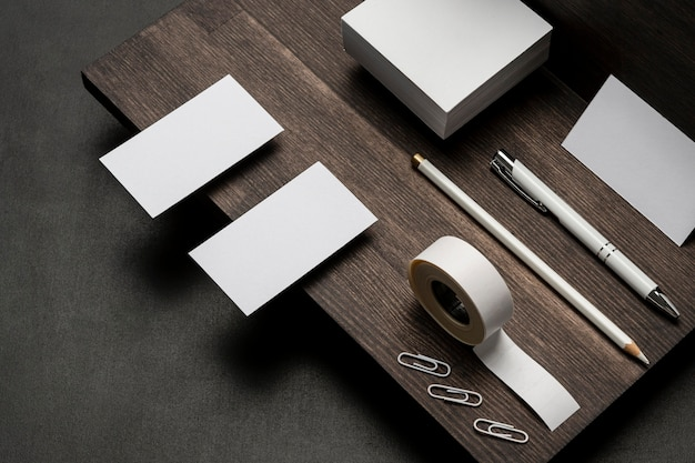 Blank white business cards and accessories on wooden table