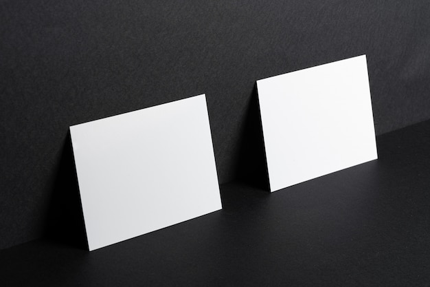 Blank white business cards leaning against the wall