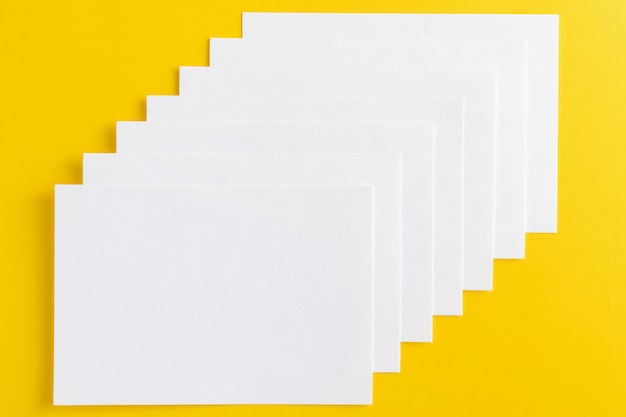 Blank white business cards stacked in row