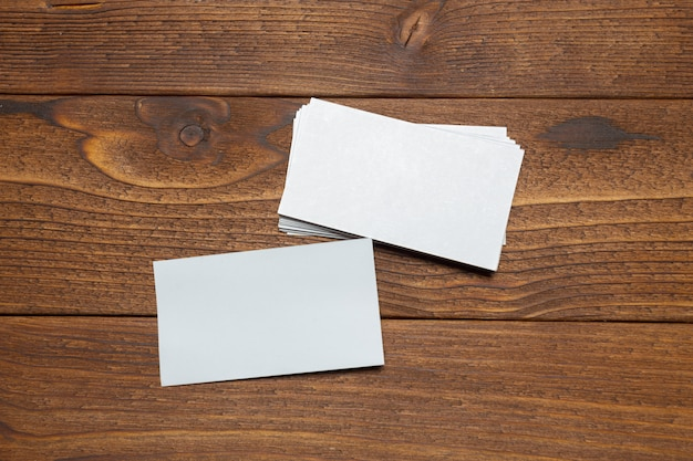 Blank white business cards on wood