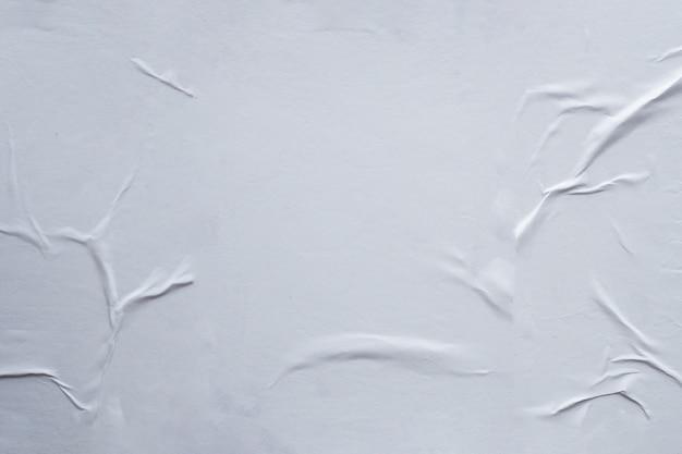 Пустой белый мятой и мятой бумаги плакат текстуры фона