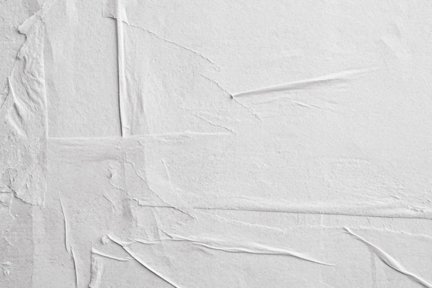 空白の白いしわくちゃにしわの紙ポスターテクスチャ背景