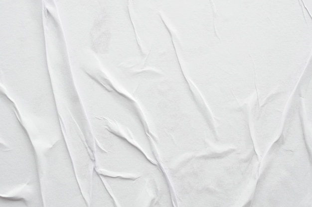 Blank white crumpled and creased paper poster texture