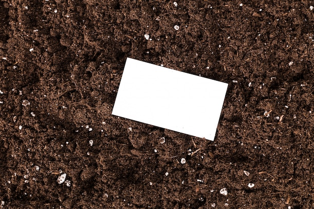 Blank white d with space for text or image on a soil texture surface,
