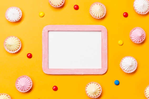Blank white frame surrounded with colorful gems and aalaw on yellow backdrop
