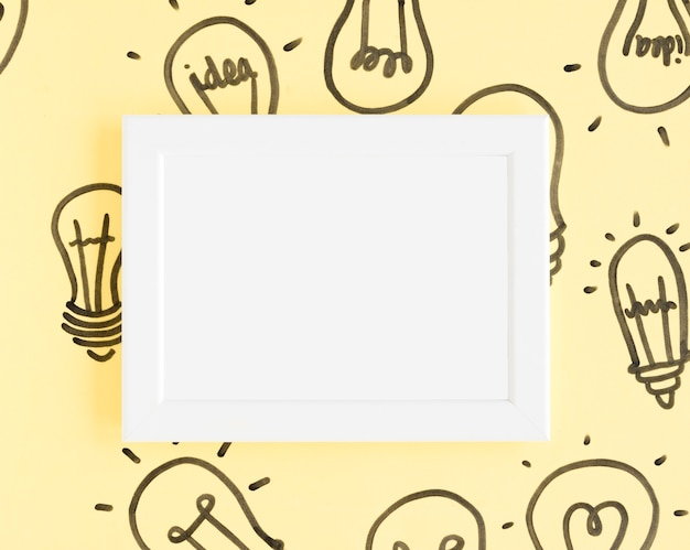 Blank white frame with light bulbs on yellow background
