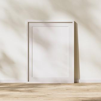 매트가 있는 빈 흰색 프레임, 흰색 벽에 나뭇잎 그림자가 있는 햇빛이 있는 나무 바닥의 포스터 프레임, 3d 렌더링
