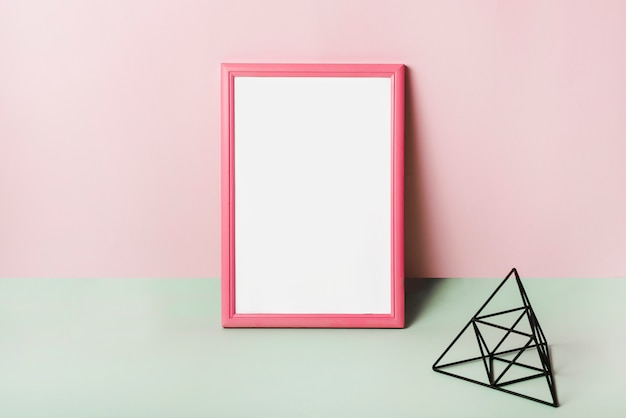 Blank white frame with pink border against pink background