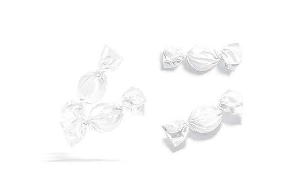 空白の白い飴玉のラッパーのモックアップ空の菓子の渦巻きパッケージのモックアップが分離されました
