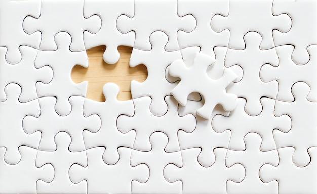 Blank white jigsaw puzzle background
