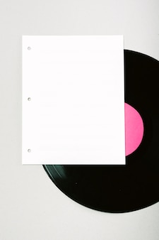 Blank white page on vinyl record against background