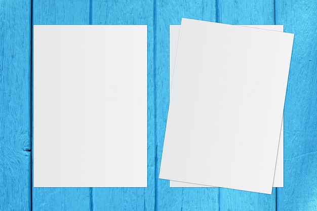 Blank white paper on blue wooden background  text input.