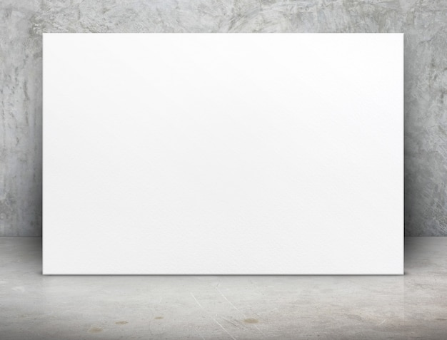 Blank white paper poster canvas at grunge concrete room