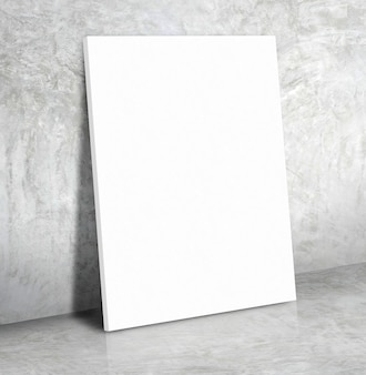 Blank white paper poster on the grey concrete wall and cement floor