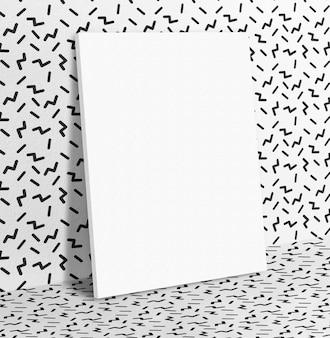 Пустой белый бумажный плакат, опирающийся на черно-белый
