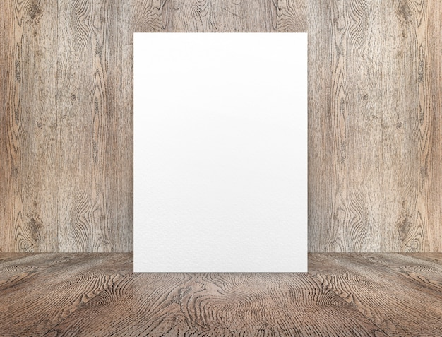 Blank white paper poster leaning at wood wall on wooden floor in perspective room