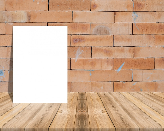 Blank white paper poster on plank wooden floor and wall.