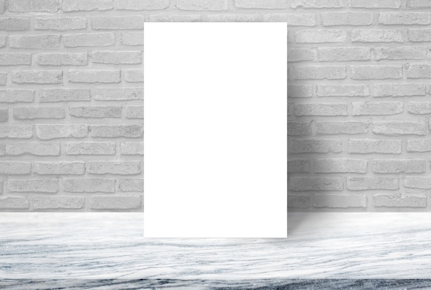 Blank white paper poster on stone table top at brick wall,template mock up for adding your design.
