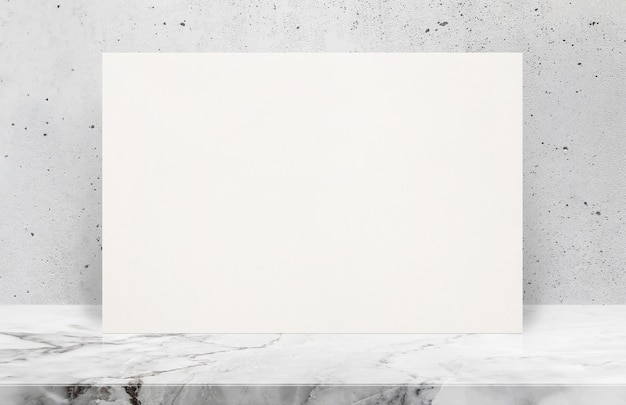 Blank white paper poster on stone table top at grey old concrete wall,template mock up for adding your design.