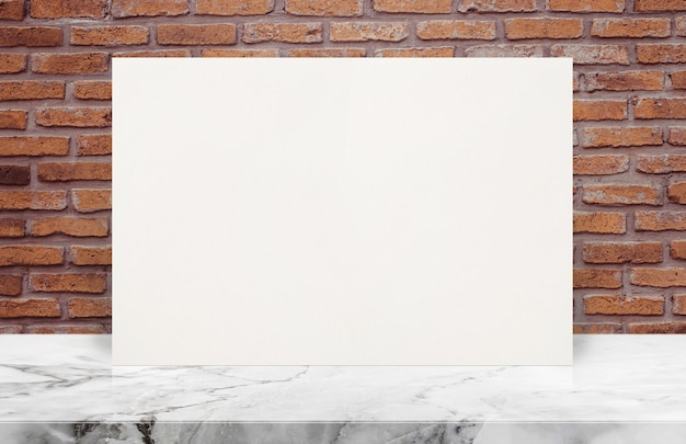 Blank white paper poster on stone table top at old brick wall,template mock up for adding your design.