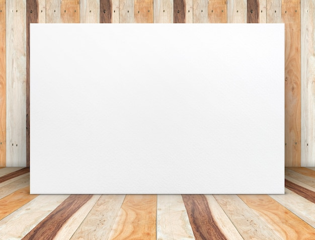 Blank white paper poster at wooden plank room.