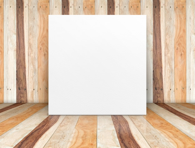 Blank white paper poster at wooden plank room