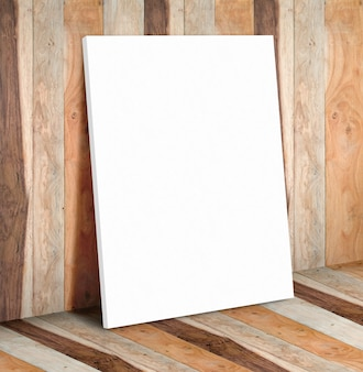 Blank white paper poster on wooden plank wall and floor