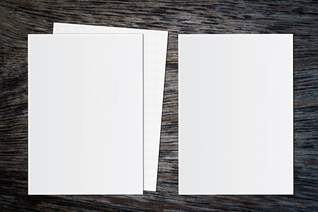 Blank white paper on wooden background. for text
