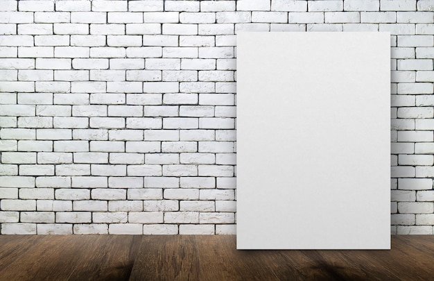 Blank white picture frame on the old brick wall and the wooden floor background