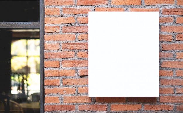 Blank white poster displayed on wall, in the front of the restaurant