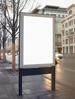 Blank white rectangular pylon stand on street